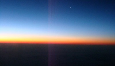 Colorful sunset from the airplane window seat.