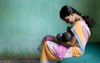 Indian Woman Breastfeeding Her Child