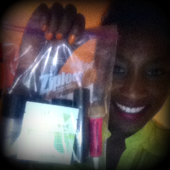 Kim White holding a ziploc baggie of her fave travel-friendly beauty products