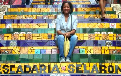 Kim sitting on the famous Escadaria Selaron steps in Rio de Janeiro, Brazil.